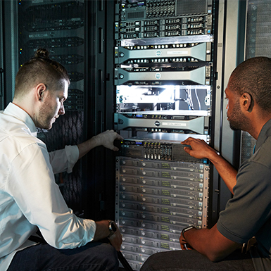 Two technicians work on optimizing a server