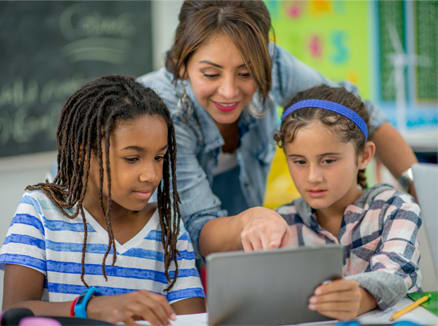 Students use technology in the classroom to enhance their learning environment