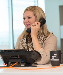 Dataprise team member using a ShoreTel phone